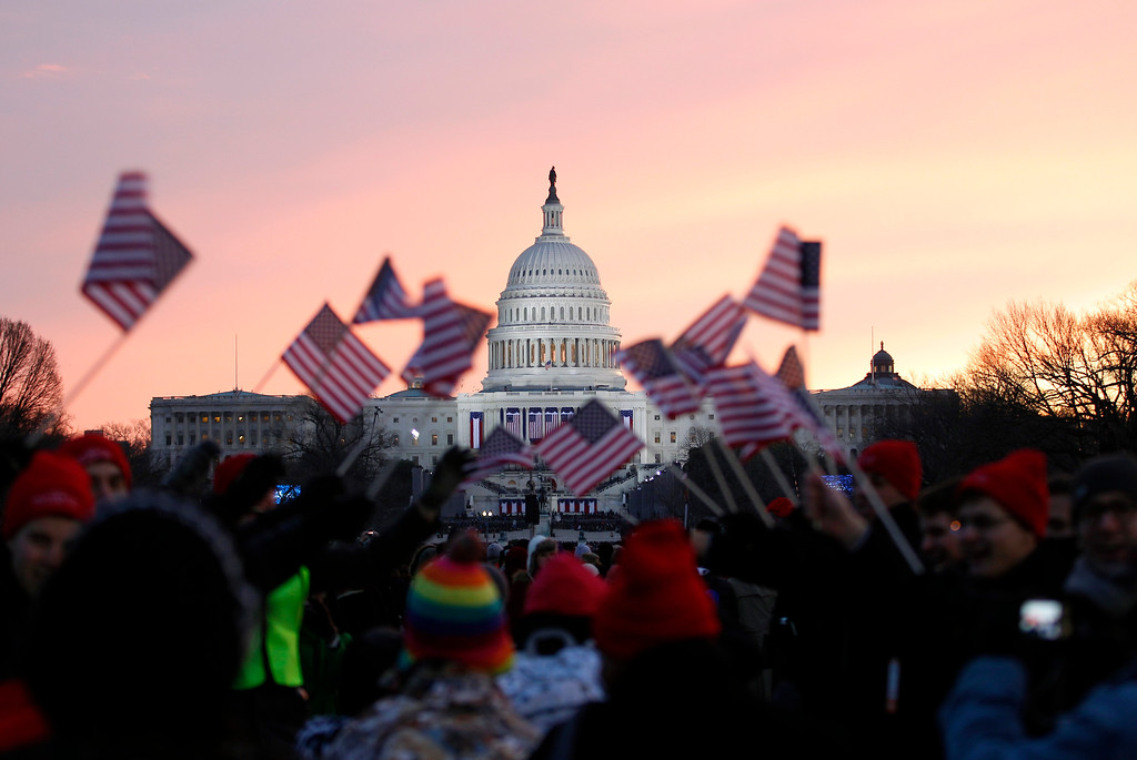 . President Barack Obama supporters wave American flags on the National Mall in Washington, Monday, Jan. 21,  2013, prior to the start of President Barack Obama\'s ceremonial swearing-in ceremony during the 57th Presidential Inauguration. ( AP Photo/Jose Luis Magana)