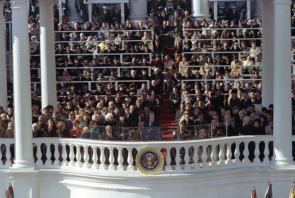 . Jimmy Carter makes his inaugural address as the 39th President of the United States during ceremony on the East Front of the Capitol in Washington, D.C., on Jan. 20, 1977.  Seated to his left is outgoing President Gerald Ford.  Seated at right is Vice President Walter F. Mondale.  (AP Photo)