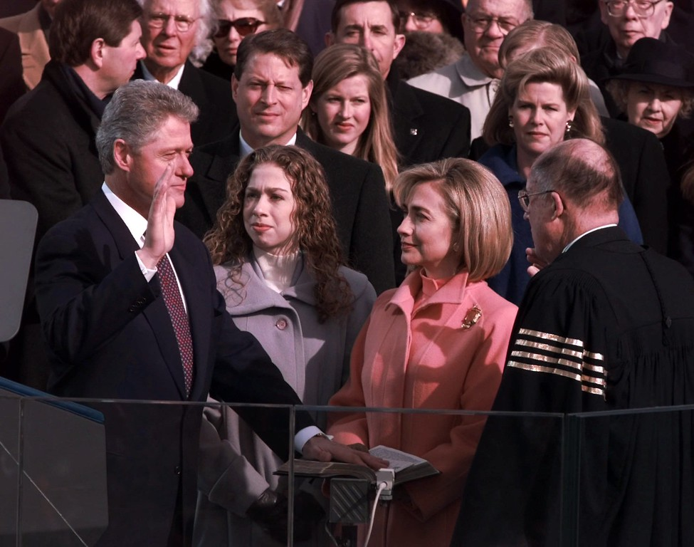 . President Clinton is sworn in for his second term Monday, Jan. 20, 1997, in Washington by Chief Justice of the United States William Rehnquist as his wife Hillary and daughter Chelsea look on. (AP Photo/Doug Mills)