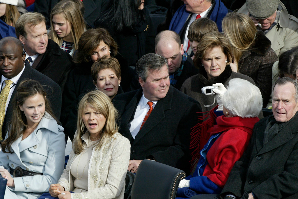 . Florida Gov. Jeb Bush, center, and members of the Bush family sit on Capitol Hill Thursday, Jan. 20, 2005 awaitng the start of President Bush\'s inauguration. From left are, daughters, Barbara and Jenna; Columba Bush, wife of the Florida governor, President Bush\'s mother and father,  Barbara and former President George H.W. Baush. (AP Photo/Stephan Savoia)