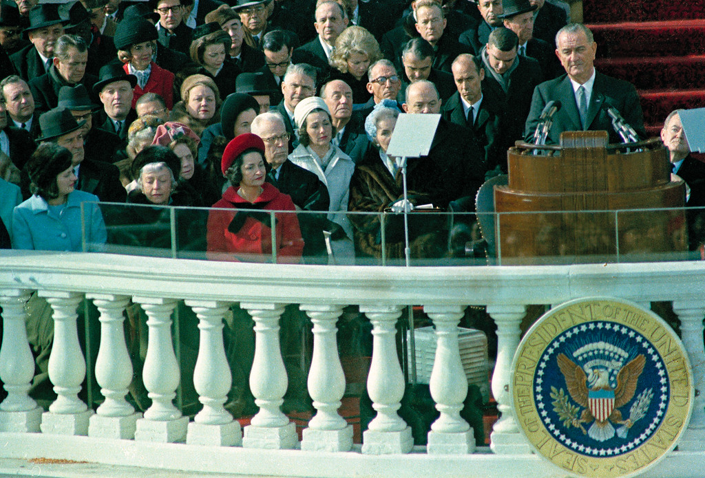 . U.S. President Lyndon B. Johnson delivers his inaugural address during inauguration ceremonies on the east portico of the Capitol building in Washington, D.C., Jan. 20, 1965.  Johnson was sworn in as the 36th president of the United States.  Visible in front row, left, is first lady Lady Bird Johnson, who held the bible as her husband took the oath of office, beginning a new tradition.  (AP Photo)