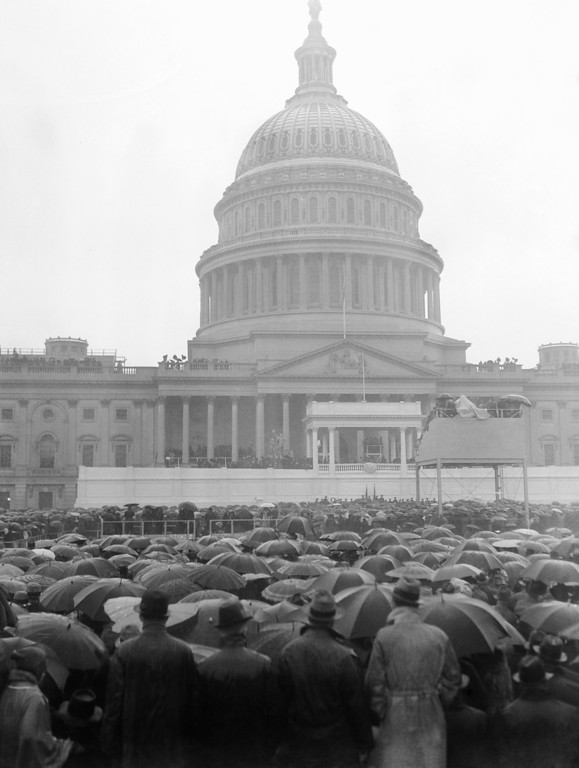 . A view looking out into the crowd as President Franklin D. Roosevelt spoke at his inaugural in Washington, Jan. 20, 1937. High dignitaries of the nation are seated near the president. High above the rain-swept crowd is the stand from which photographers made pictures of the inaugural itself. (AP Photo)