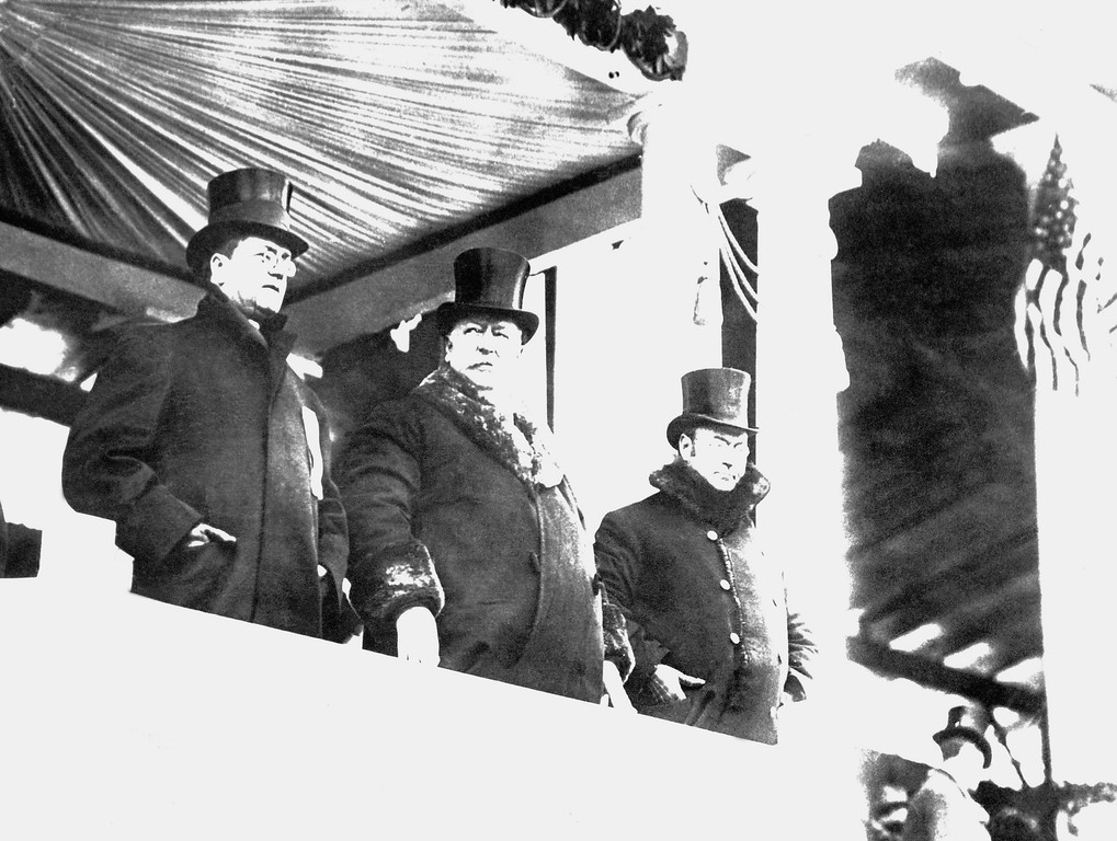 . William Howard Taft, center, wore big fur-lined overcoat when he reviewed parade after his inauguration as president, on March 4, 1909 in Washington.  At right is James S. Sherman, vice president of the United States, and at left Edward Hallwagon, chief of the Inaugural Committee.    A whirling blizzard, featured by flashes of lighting, as well as rain, snow and a cutting wind, made it one of the roughest of all inauguration days. (AP Photo)