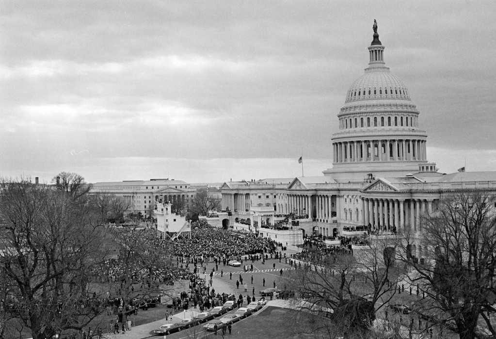 . The east side of the Capitol Building is the setting today as President Richard Nixon is sworn in for a second term in Washington, D.C., Jan. 20, 1973.  The American flag is at half staff to honor the late President Harry S. Truman.  (AP Photo)