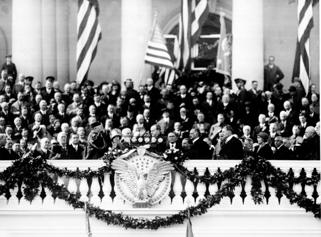 . Calvin Coolidge, center right, takes the oath of office administered by Chief Justice William H. Taft on the east portico of the Capitol building in Washington, D.C., March 4, 1925.  Coolidge is sworn in as the 30th president of the United States.  (AP Photo)