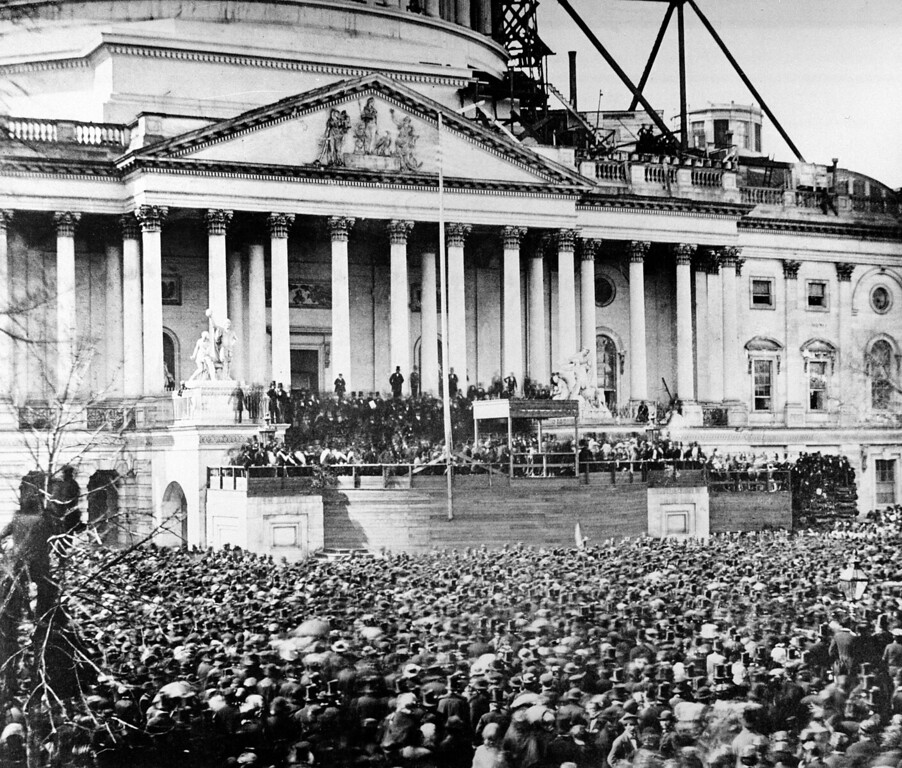 . U.S. President Abraham Lincoln stands under cover at center of Capitol steps during his inauguration in Washington, D.C., on March 4, 1861.  The scaffolding at upper right is used in construction of the Capitol dome.  (AP Photo)