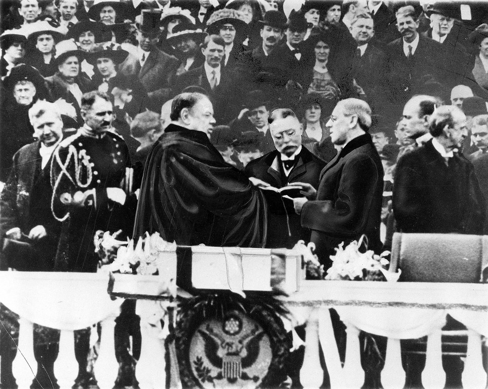 . Woodrow Wilson takes the oath of office for his first term of the Presidency on the East Portico at the U.S. Capitol in Washington, D.C., on March 4, 1913.  Chief Justice is Edward D. White.  (AP Photo)
