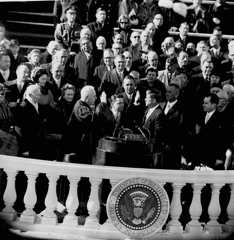. Chief Justice Earl Warren administers oath of office to President of the United States John F. Kennedy in Washington, D.C. January 20, 1961. Lyndon B. Johnson, the new Vice President, is at right. Holding Bible at center is James R. Browning, clerk of the U.S. Supreme Court. Richard M. Nixon stands at far right. (AP PHOTO)