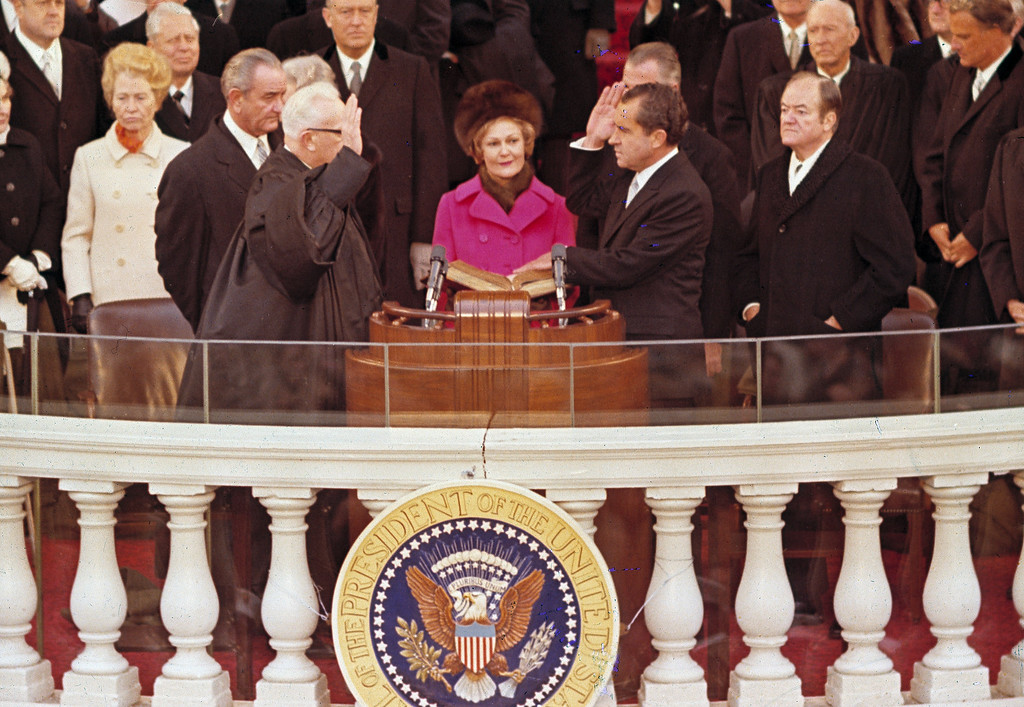 . Richard M. Nixon, right, is sworn in as the 37th president of the United States administered by Chief Justice Earl Warren, left, during inaugural ceremonies in front of the Capitol in Washington, D.C., Jan. 20, 1969.  Shown behind Warren is former President Lyndon B. Johnson.  (AP Photo)