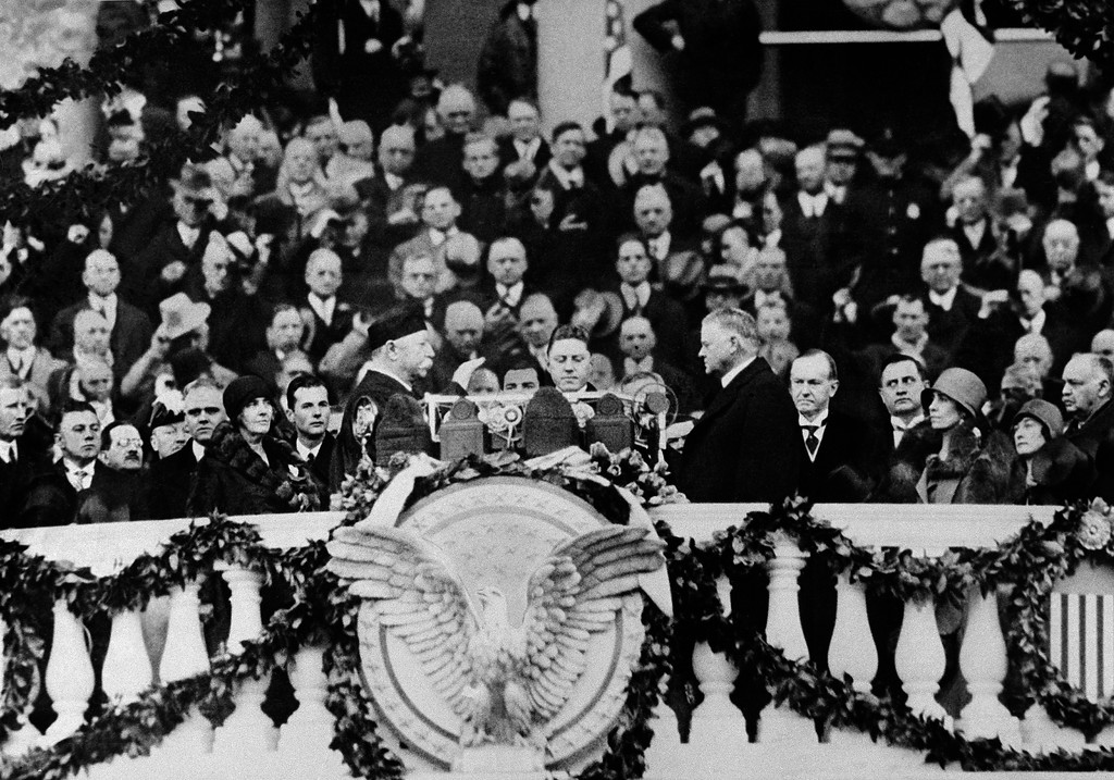 . Herbert Hoover takes the oath of office from Chief Justice William Howard Taft as 31st president of the United States in Washington, March 4, 1929. (AP Photo)