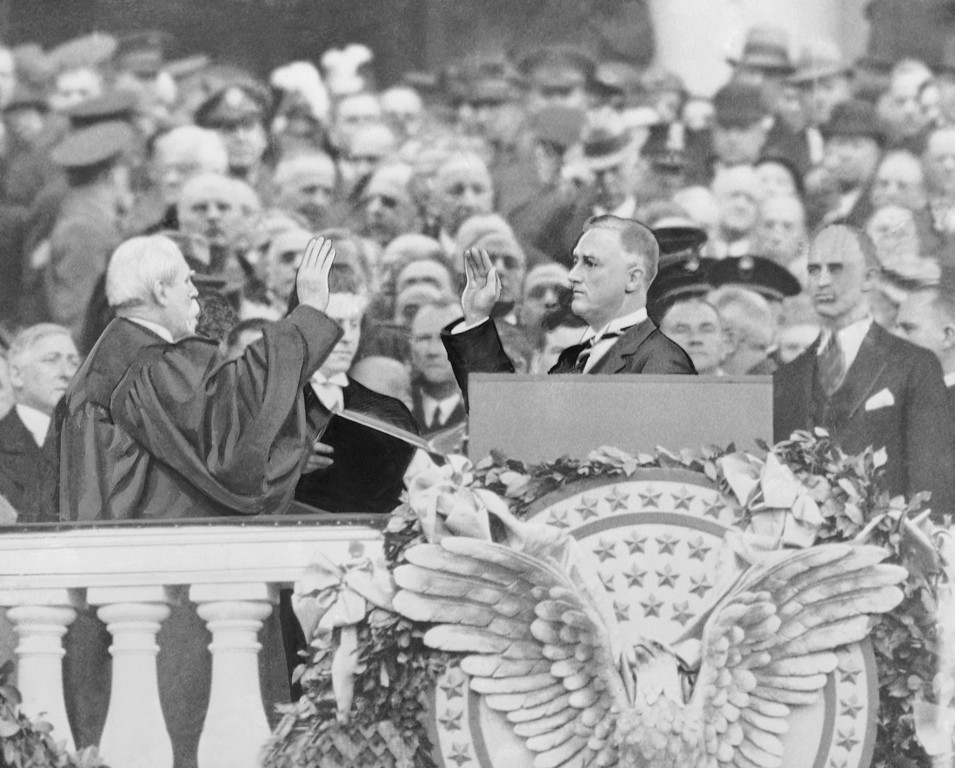 . Franklin Delano Roosevelt takes the oath of office as the 32nd president of the United States from Chief Justice Charles Evans Hughes, March 4, 1933.  (AP Photo)