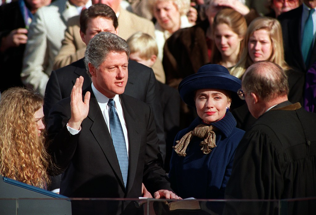 ". William Jefferson ""Bill\"" Clinton, with his wife Hillary Rodham Clinton and daughter Chelsea at his side, takes the oath of office as 42nd president of the United States from Chief Justice William H. Rehnquist on the west steps of the Capitol in Washington Wednesday, Jan. 20, 1993. (AP Photo/Ed Reinke)"