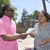 ANNE NEBORAK-DIGITAL FIRST MEDIA Running for Darby Borough Council, 2nd Ward in is John P. Metts, Sr. he is talking to Karen Smith.
