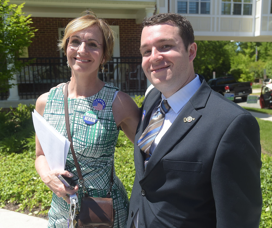 . PETE BANNAN _ DIGITAL FIRST MEDIA  West Chester mayoral candidates Dianne Herrin and Kyle Hudson Tuesday afternoon at Ward 1 at the Mary Taylor House.