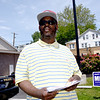 ANNE NEBORAK-DIGITAL FIRST MEDIA Thomas Davis waits to give out literature to voters outside the Darby Borough's Municipal building. He is the son of Janis Davis .