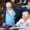 ANNE NEBORAK-DIGITAL FIRST MEDIA Carmella Strano, Judge of Elections loks at the Books with Ellen Morrisroe Majority Clerk as they wait for voters in Norwood at the polling place 105 Trites Avenue In Norwood.