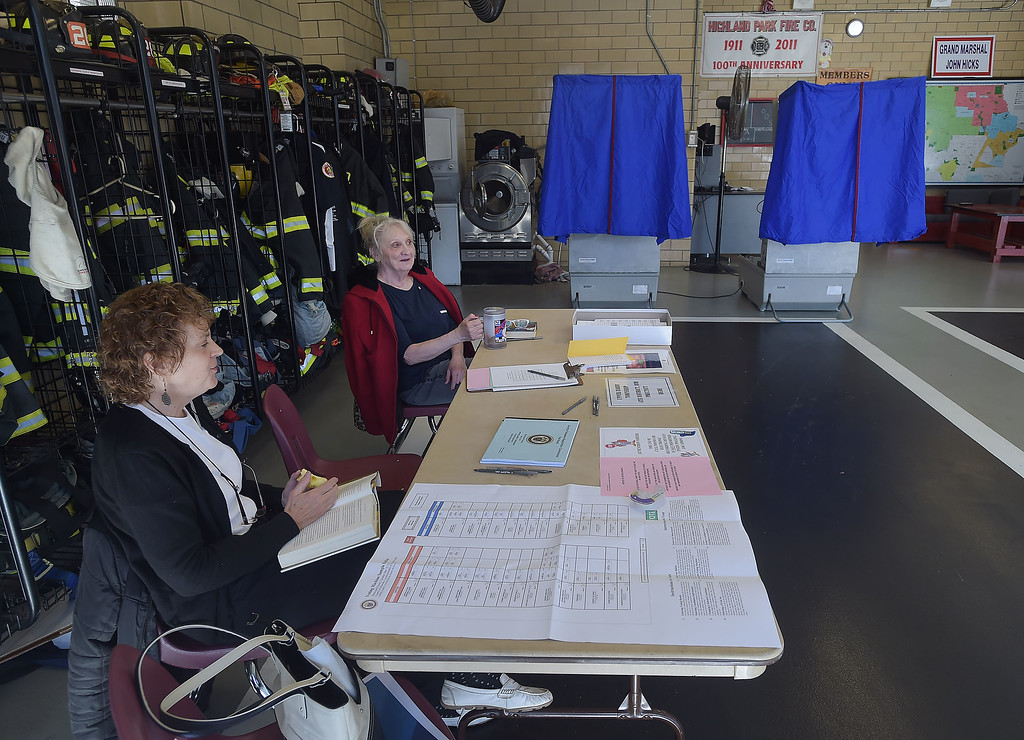 . PETE BANNAN _ DIGITAL FIRST MEDIA    Poll workers at Upper Darby  District 4- precinct 8 wait for voters Tuesday morning at Highland Park Fire Company. Turnout was light throughout the day.
