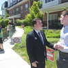 PETE BANNAN _ DIGITAL FIRST MEDIA  West Chester maoral candidate Kyle Hudson talks to Ethan Healey Tuesday afternoon at Ward 1 at the Mary Taylor House.