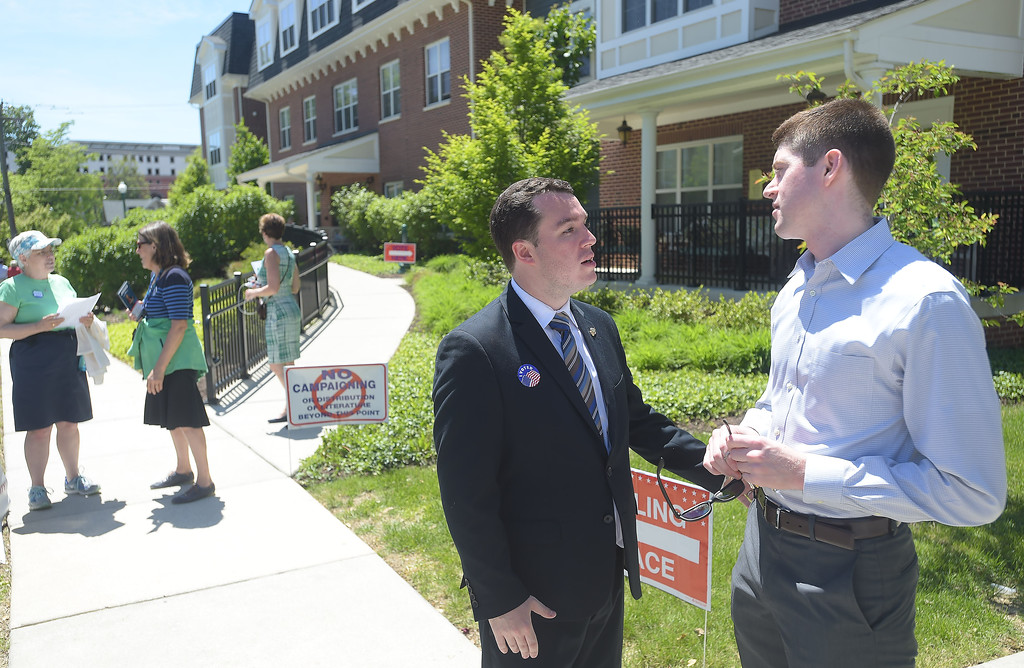 . PETE BANNAN _ DIGITAL FIRST MEDIA  West Chester maoral candidate Kyle Hudson talks to Ethan Healey Tuesday afternoon at Ward 1 at the Mary Taylor House.