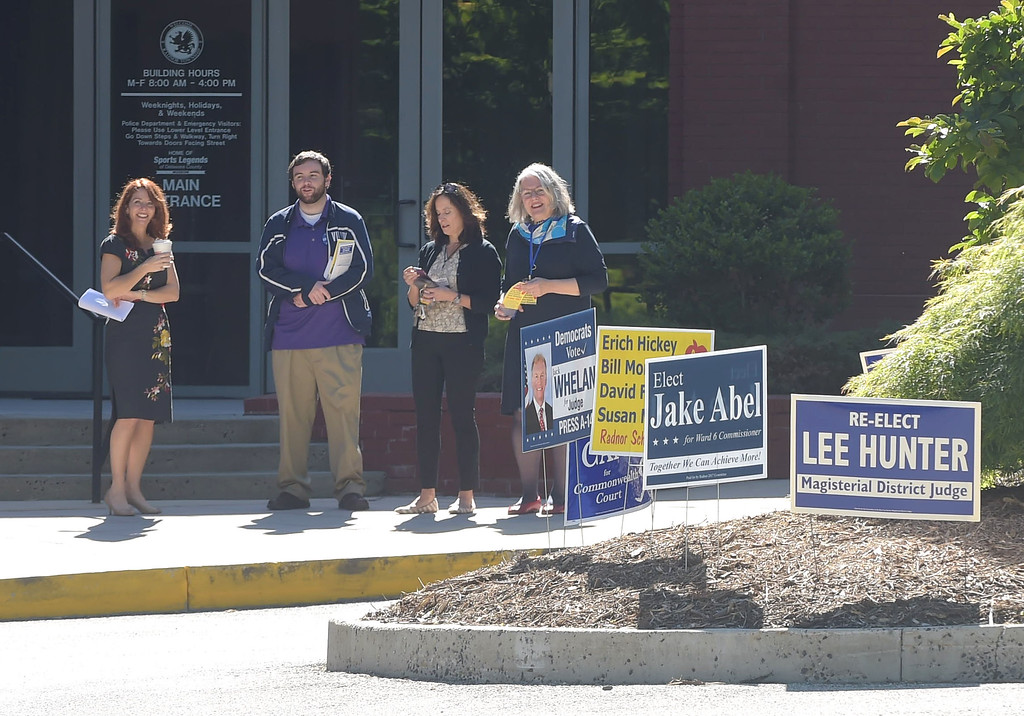 . PETE BANNAN _ DIGITAL FIRST MEDIA    Mollie Plotkin, candidate for  Radnor commissior, volunteer Ryan DeMara,  Radnor treasurer, candidate Kathryn Gartland  and Susan Michaelson, candidate for Radnor school board wait for voters at the Radnor Municipal building Tuesday morning.