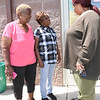 ANNE NEBORAK-DIGITAL FIRST MEDIA Janis Davis running for Darby Council talks to Irma Bruton and Norita Young before voting.