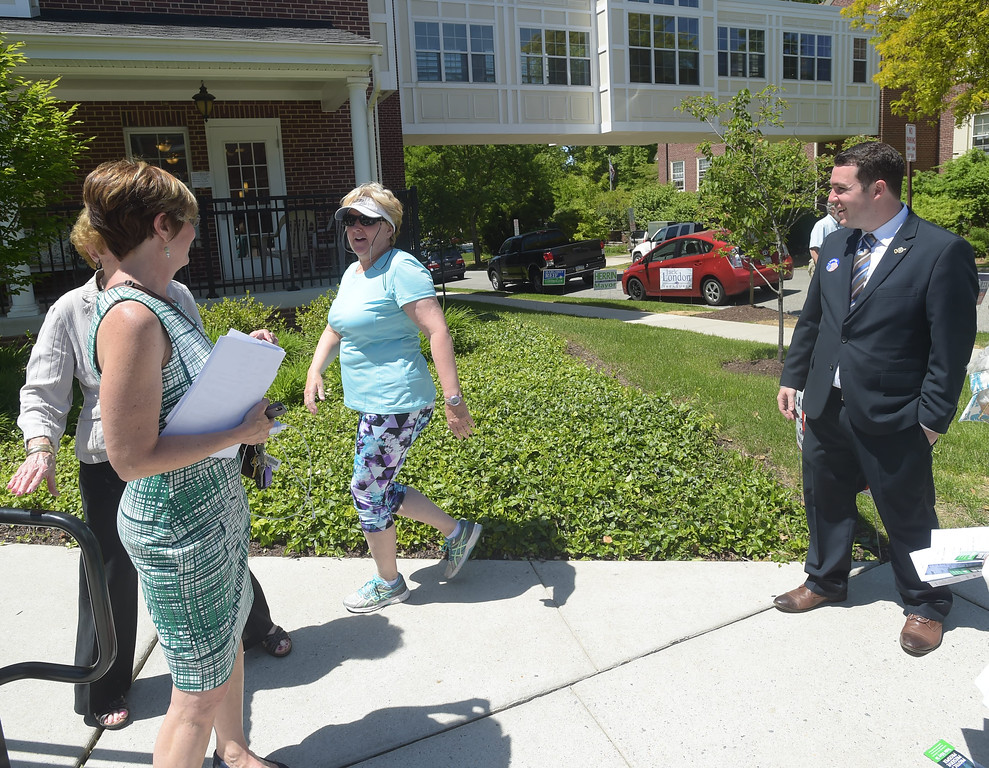. PETE BANNAN _ DIGITAL FIRST MEDIA  West Chester mayoral candidates Dianne Herrin and Kyle Hudson talk with Linda Williams, center, Tuesday afternoon at Ward 1 at the Mary Taylor House.