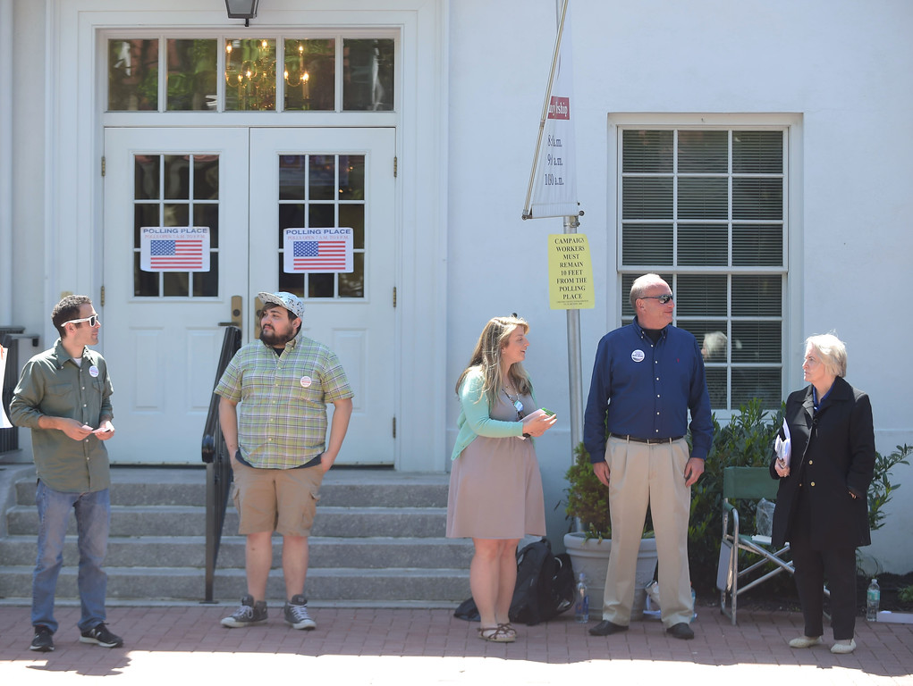 . PETE BANNAN _ DIGITAL FIRST MEDIA   Matthew Eckmanm Wilhem Alcivar, Lindsey Walaski , Jeff Heim and Janet Colliton wait for voters Tuesday morning at Ward 6, at the 1st Presbyterian Church.