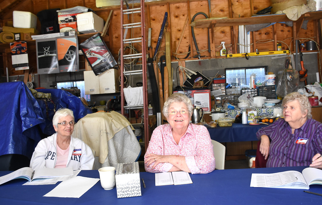 . ANNE NEBORAK-DIGITAL FIRST MEDIA Carol Quinn greets voters at her garage which twice a year is a polling place. She sits in the center. To the left of her is Ellen Morrisroe , the Majority leader, to the right is Clere Marie Manspeaker. The garage is at 105 Trites Avenue in Norwood.