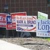 PETE BANNAN _ DIGITAL FIRST MEDIA    Campaign signs line the walk in front of the West Chester Borough Hall.