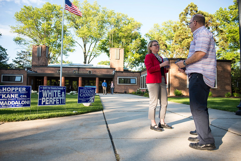 RICK KAUFFMAN - DIGITAL FIRST MEDIA <br /> Jennifer Lofland, left, speaks with Mark and Brenda Kucirka outside the Springfield Township Library on Tuesday. Lofland was running for re-election to the Springfield School Board.