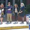 PETE BANNAN _ DIGITAL FIRST MEDIA    Mollie Plotkin, candidate for  Radnor commissior, volunteer Ryan DeMara,  Radnor treasurer, candidate Kathryn Gartland  and Susan Michaelson, candidate for Radnor school board great a voter at the Radnor Municipal building Tuesday morning.