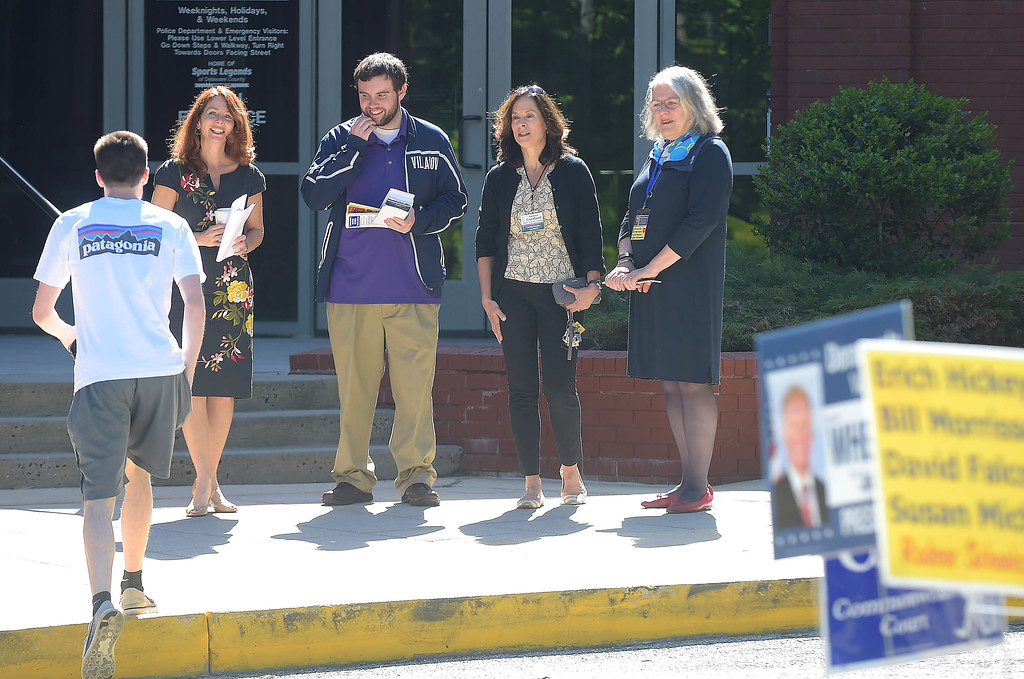 . PETE BANNAN _ DIGITAL FIRST MEDIA    Mollie Plotkin, candidate for  Radnor commissior, volunteer Ryan DeMara,  Radnor treasurer, candidate Kathryn Gartland  and Susan Michaelson, candidate for Radnor school board great a voter at the Radnor Municipal building Tuesday morning.