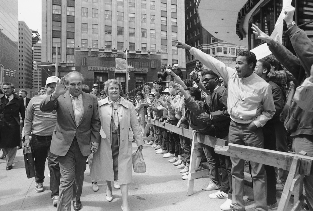 . Villanova coach Rollie Massimino, left, waves as he walks past cheering fans to a victory ceremony at Philadelphia�s John F. Kennedy Plaza  Tuesday, April 2, 1985 after his team won the NCAA basketball championship over Georgetown in Lexington. (AP Photo/David Fields)