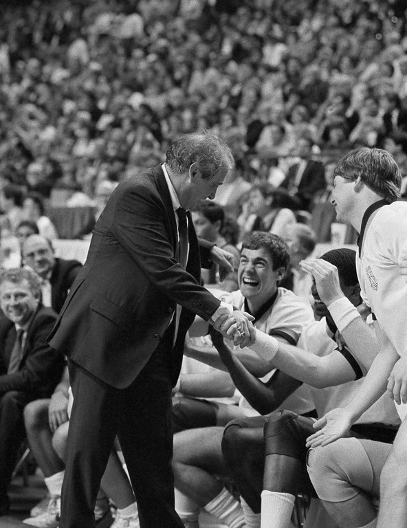 . Villanova Coach Rollie Massimino is congratulated by the wildcat bench after they defeated Memphis State in the NCAA semifinals at Lexington?s Rudo Arena, Saturday, March 30, 1985. (AP Photo)