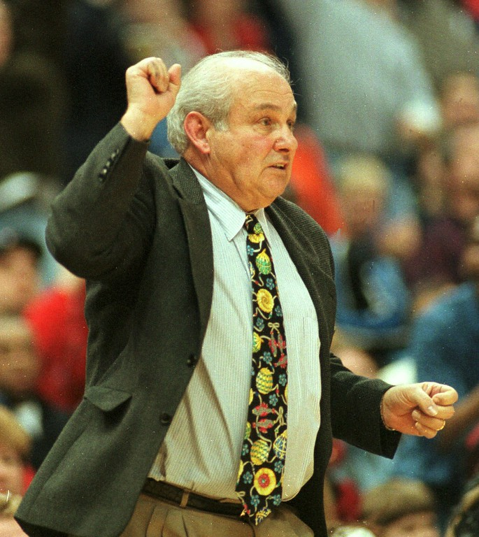 . Cleveland State Vikings coach Rollie Massimino pumps his fist during the second half of the Rock and Roll Shootout Sunday, Dec. 27, 1998 at Gund Arena in Cleveland. Cleveland beat Rhode Island 73-72. (AP Photo/Tony Dejak)