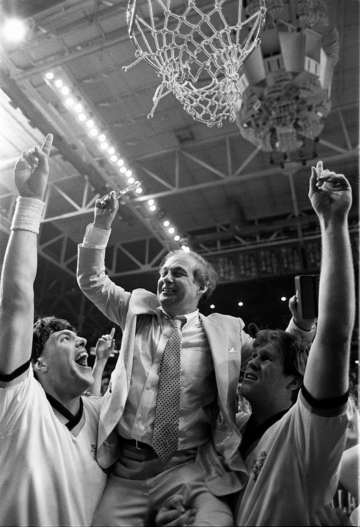 . FILE - In this April 1, 1985, file photo, Villanova coach Rollie Massimino is lifted up to cut the net down after winning NCAA men\'s college basketball championship against Georgetown, in Lexington, Ky. It\'s been 30 years since Villanova won the national championship in one of the most shocking upsets in sports history. (AP Photo/Bob Jordan, File)