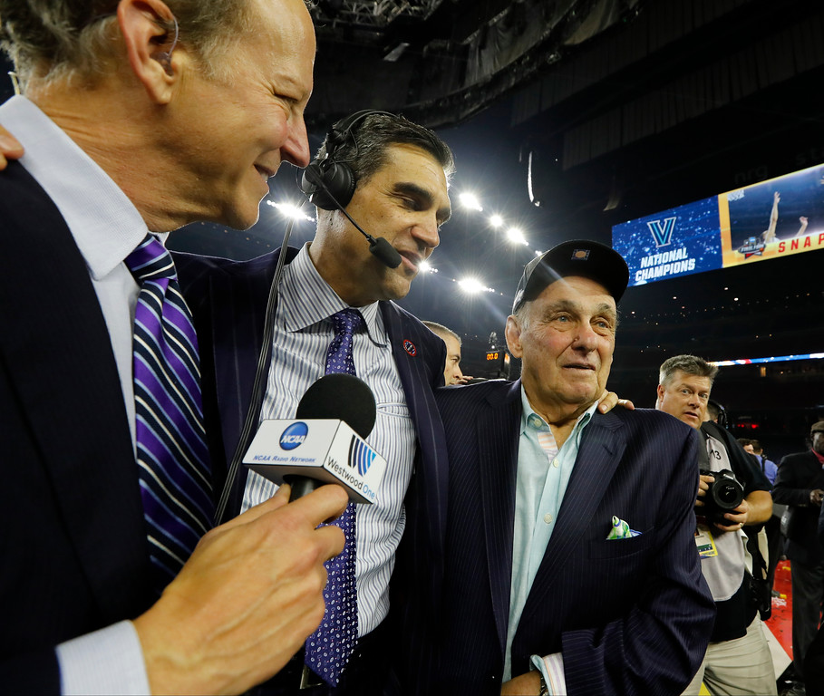 . Villanova head coach Jay Wright, center, celebrates with 1985 Villanova coach Rollie Massimino, right, after the NCAA Final Four tournament college basketball championship game North Carolina, Monday, April 4, 2016, in Houston. Villanova won 77-74. (AP Photo/David J. Phillip)