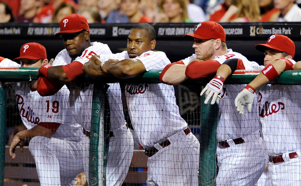 . ADVANCE FOR WEEKEND EDITIONS, SEPT. 7-8 - FILE - In this Aug. 2, 2013, file photo, Philadelphia Phillies\' Roy Halladay, third from right, watches from the dugout railling with teammates during a baseball game against the Atlanta Braves in Philadelphia. The Phillies are heading toward their first losing season since going 80-81 in 2002.  (AP Photo/Michael Perez)