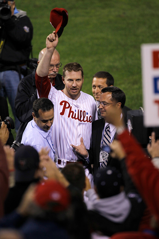 . Philadelphia Phillies starting pitcher Roy Halladay tips his hat to the crowd after throwing a no-hitter to defeat the Cincinnati Reds 4-0 during Game 1 of the National League Division baseball series Wednesday, Oct. 6, 2010, in Philadelphia. (AP Photo/Matt Rourke)