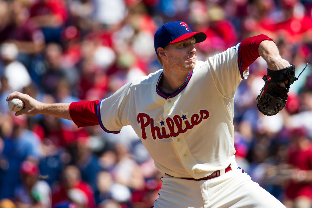 . FILE - In this Aug. 24, 2013, file photo, Philadelphia Phillies starting pitcher Roy Halladay throws a pitch during the first inning of a baseball game against the Arizona Diamondbacks, in Philadelphia. Authorities have confirmed that former Major League Baseball pitcher Roy Halladay died in a small plane crash in the Gulf of Mexico off the coast of Florida, Tuesday, Nov. 7, 2017.  (AP Photo/Christopher Szagola, File)