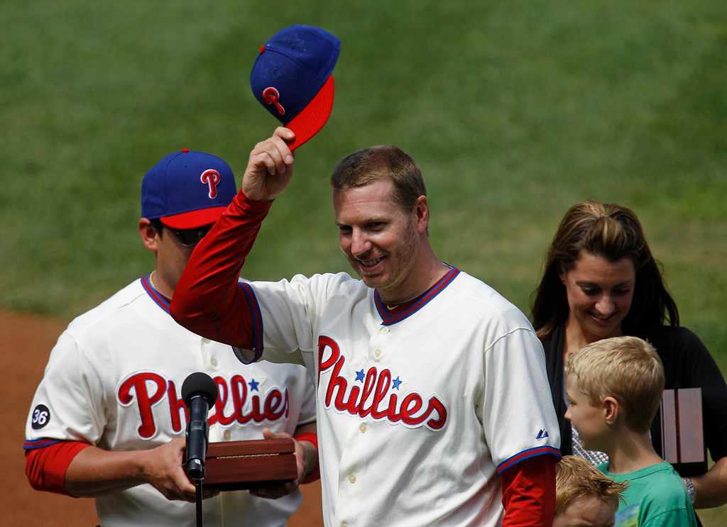 . Philadelphia Phillies pitcher Roy Halladay, accompanied by his wife Brandy and two sons, is honored during a ceremony  for his perfect game against the Florida Marlins in May, before the Phillies\' baseball game against the Houston Astros in Philadelphia, Thursday, Aug. 26, 2010. Houston won 5-1. (AP Photo/Matt Rourke)