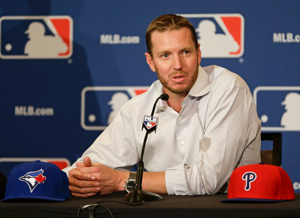 . Two-time Cy Young Award winner Roy Halladay answers questions after announcing his retirement after 16 seasons in the major leagues with Toronto and Philadelphia at the MLB winter meetings in Lake Buena Vista, Fla., Monday, Dec. 9, 2013.(AP Photo/John Raoux)
