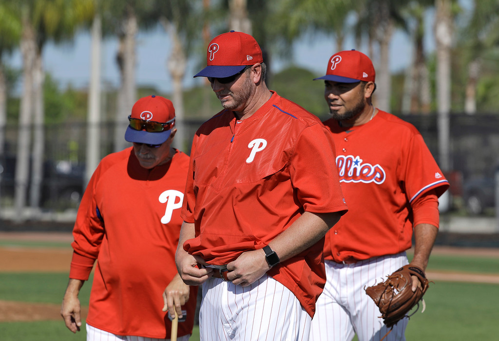 . Former Philadelphia Phillies pitcher Roy Halladay, center, walks off the field with pitching coach Bob McClure and relief pitcher Joaquin Benoit after a workout Thursday, March 9, 2017, in Clearwater, Fla. Halladay is back with the Phillies as a guest instructor. (AP Photo/Chris O\'Meara)