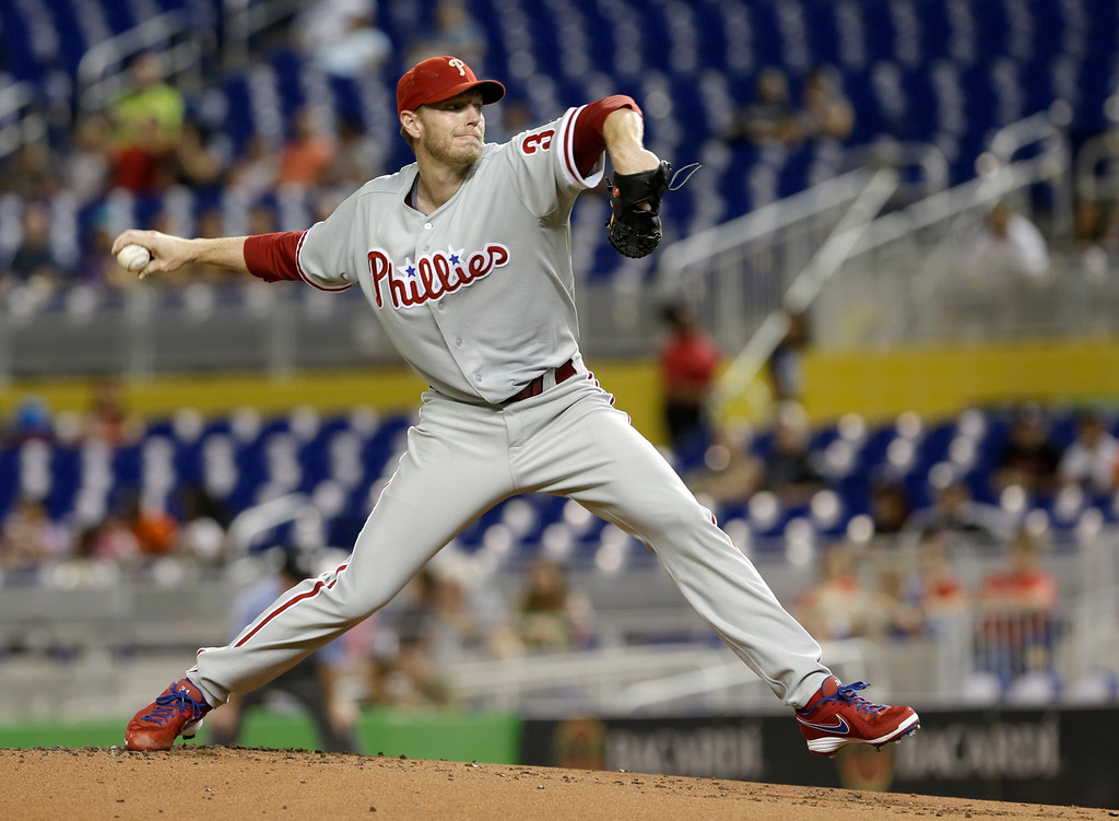 . Philadelphia Phillies\' Roy Halladay pitches against the Miami Marlins in the first inning of a baseball game,  Monday, Sept. 23, 2013, in Miami.  (AP Photo/Alan Diaz)