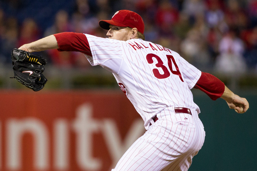 . Philadelphia Phillies starting pitcher Roy Halladay  delivers against the Miami Marlins during the fourth inning of a baseball game, Tuesday, Sept. 17, 2013, in Philadelphia.  The Phillies win 6-4. (AP Photo/Chris Szagola)