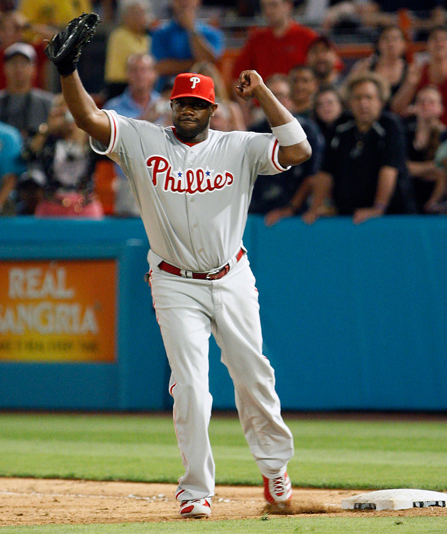 . Philadelphia Phillies first baseman Ryan Howard celebrates at the last out after pitcher Roy Halladay threw a perfect baseball game  against the Florida Marlins, Saturday, May 29, 2010, in Miami. The Phillies defeated the Marlins 1-0. (AP Photo/Wilfredo Lee)