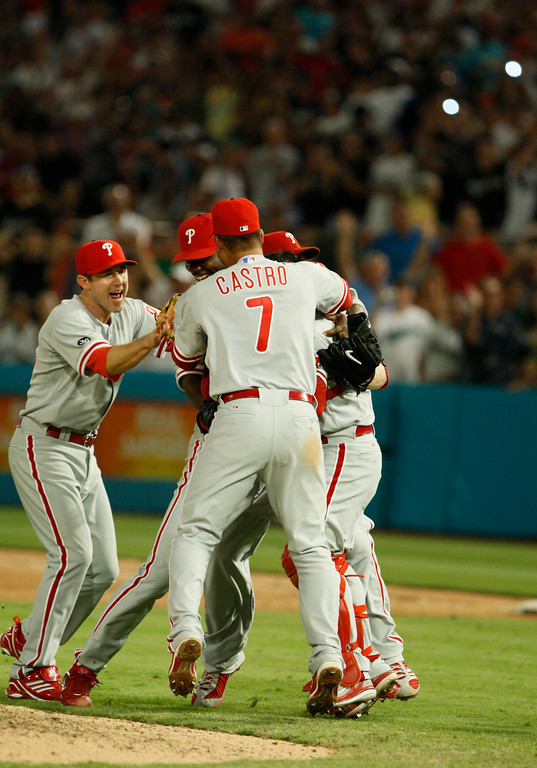 . Philadelphia Phillies starting pitcher Roy Halladay is mobbed by teammates after he threw a perfect game during a baseball game against the Florida Marlins, Saturday, May 29, 2010 in Miami. The Phillies defeated the Marlins 1-0. (AP Photo/Wilfredo Lee)