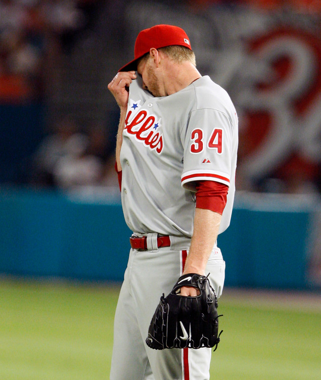 . Philadelphia Phillies starting pitcher Roy Halladay wipes his brow in the ninth inning of a baseball game against the Florida Marlins, Saturday, May 29, 2010 in Miami. Halladay threw a perfect game as the Phillies defeated the Marlins 1-0. (AP Photo/Wilfredo Lee)