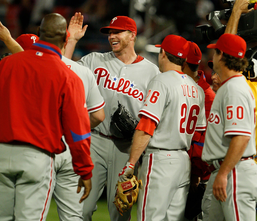 . Philadelphia Phillies starting pitcher Roy Halladay is congratulated by teammates  after he threw a perfect game during a baseball game against the Florida Marlins, Saturday, May 29, 2010 in Miami. The Phillies defeated the Marlins 1-0. (AP Photo/Wilfredo Lee)