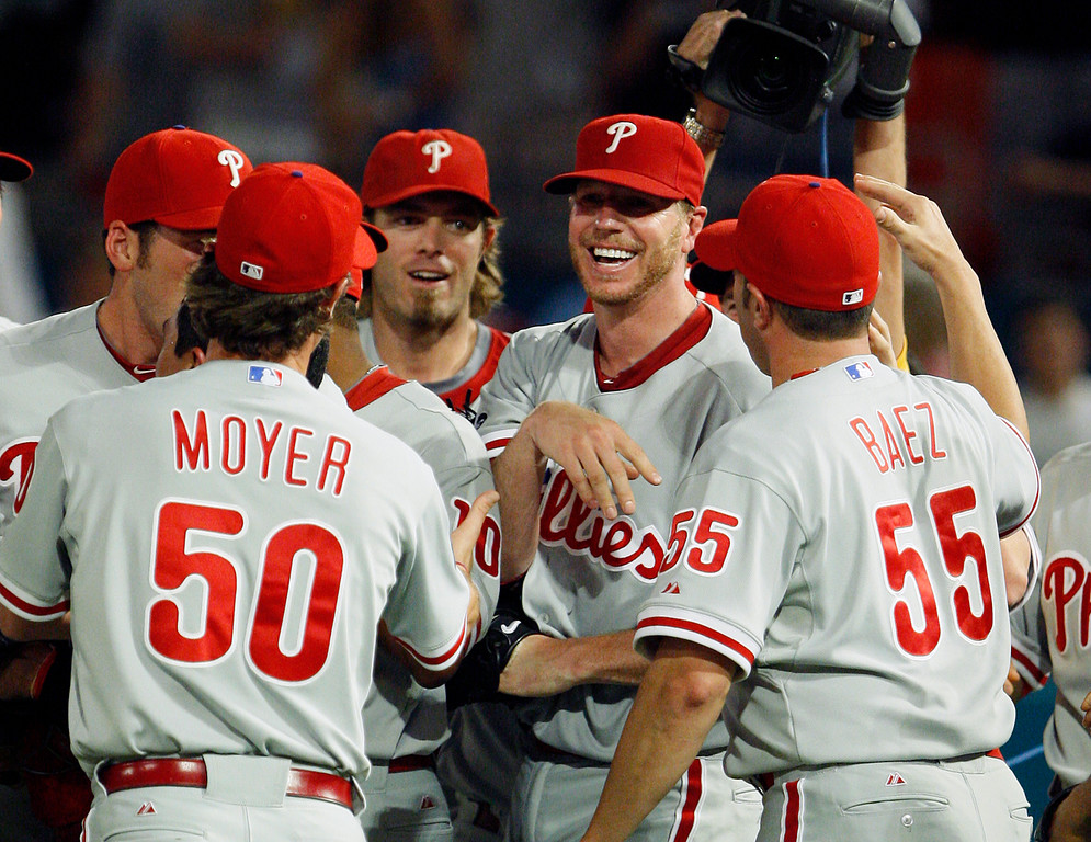 . Philadelphia Phillies starting pitcher Roy Halladay, second from right, is mobbed by teammates after throwing a perfect baseball game against the Florida Marlins, Saturday, May 29, 2010, in Miami. The Phillies defeated the Marlins 1-0. (AP Photo/Wilfredo Lee)